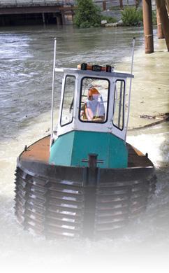 Clearing debris jam under the Port Mann Bridge, Forrest Marine Ltd